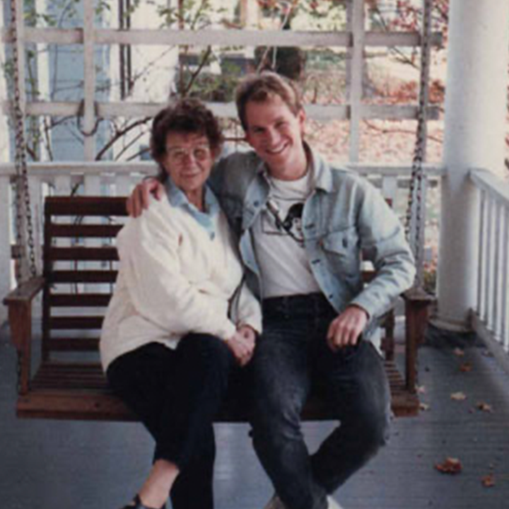Ray Ratke and his mother sit on a porch swing